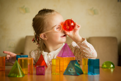 little girl playing with geometrical shapes
