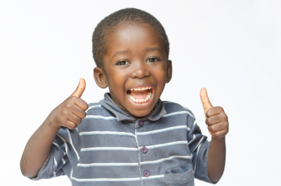 little boy showing his thumbs up